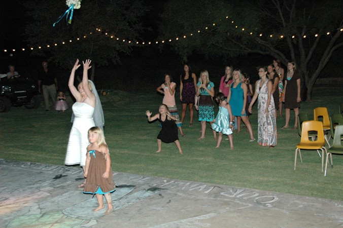 """Bouquet Toss Under Night Lighting From A Walk To Remember...See More Below"""